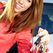 Car driver woman smiling showing new car keys and car. — Stock Photo
