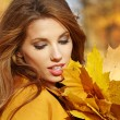 Portrait of very beautiful young woman in autumn park — Stock Photo