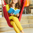 Young beautiful student girl  in hammock — Stock Photo