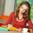 Lovely student girl in cafe — Stock Photo #33317325