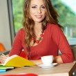 Lovely student girl in cafe — Stok Fotoğraf #33317327