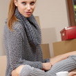 Young woman unpacking boxes — Stock Photo