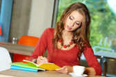 Lovely student girl in cafe — Stock Photo