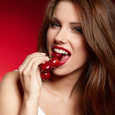 Happy woman with cherries over white — Stock Photo