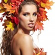 Stock Photo: Autumn Woman. Beautiful creative makeup