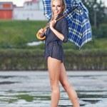 Beautiful sexy woman with blue umbrella on rainy day — Stock Photo #33471875