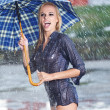 Beautiful sexy woman with blue  umbrella on rainy day  — Stock Photo