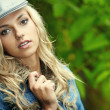 Sexy blonde in blue jeans — Stock Photo