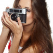 Young and beautiful woman with retro camera — Stock Photo