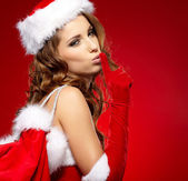 Christmas woman on red background — Stock Photo