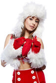 Pin-up sexy girl wearing santa claus clothes — Stock Photo