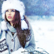 Woman in winter park — Stockfoto