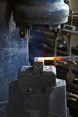 Incandescent element in the smithy on the anvil — Stock Photo
