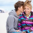 Couple embracing and having fun wearing warm clothes outside on  — Lizenzfreies Foto