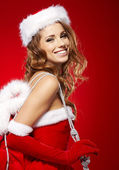 Attractive young woman in Santa Claus costume — Stock Photo