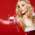 Santa woman with a christmas gift — Stock Photo #34344269