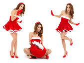 Sexy girl wearing santa claus clothes with gifts — Stock Photo