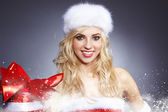 Santa woman with a christmas gift — Foto Stock