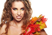 Beautiful woman with autumn leaves — Stock Photo