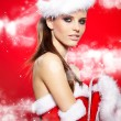 Santa woman with a christmas gift — Stock Photo #34587413