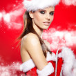 Santa woman with a christmas gift — Stock Photo