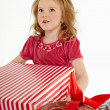 Little girl with christmas gift — Lizenzfreies Foto