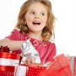 Little girl with christmas gift — стоковое фото #34767419