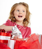 Little girl with christmas gift — Stockfoto