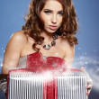 Beautiful brunette woman with a gift boxes  — Stock Photo