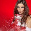 Girl wearing santa claus clothes — Stockfoto