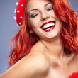 Christmas Santa hat redhead woman portrait . Smiling happy girl — Stock Photo