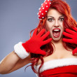 Christmas Santa hat redhair woman portrait . Smiling happy girl — Stock Photo