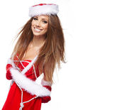 Beautiful woman wearing a santa costume — Stock Photo