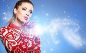 Christmas Girl.Winter woman Blowing Snow — Stockfoto