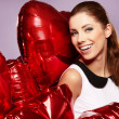 Stock Photo: Womwith heart-shaped balloons