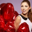 Woman with a heart-shaped balloons — Stock Photo