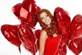 Žena s balónky-červené srdce — Stock fotografie