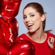 Stock Photo: Woman with heart-shaped balloons