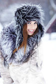 Girl playing with snow in park — Stock Photo