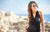 Beautiful girl in dress on coast — Foto Stock