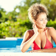 Beautiful young woman at a pool  — Stock Photo #37416303