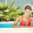 Beautiful young woman at a pool — Stockfoto