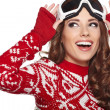 Stock Photo: Young girl snowboarding