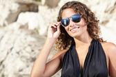 Girl in dress on the coast — Stockfoto