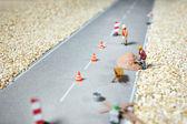 Road renovation in progress . Macro figurine — Stock Photo