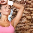 Fitness woman under palm in resort — Stock Photo #38690359