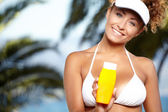 Woman in bikini smear protective cream — Stock Photo