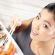 Young woman eating sushi — Stock Photo #38889505