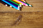 Set of color pencils on old wooden — Stockfoto