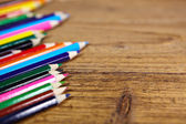 Set of color pencils on old wooden — Stock Photo